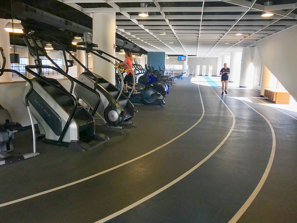 UNF gym image of stair machines and the track.
