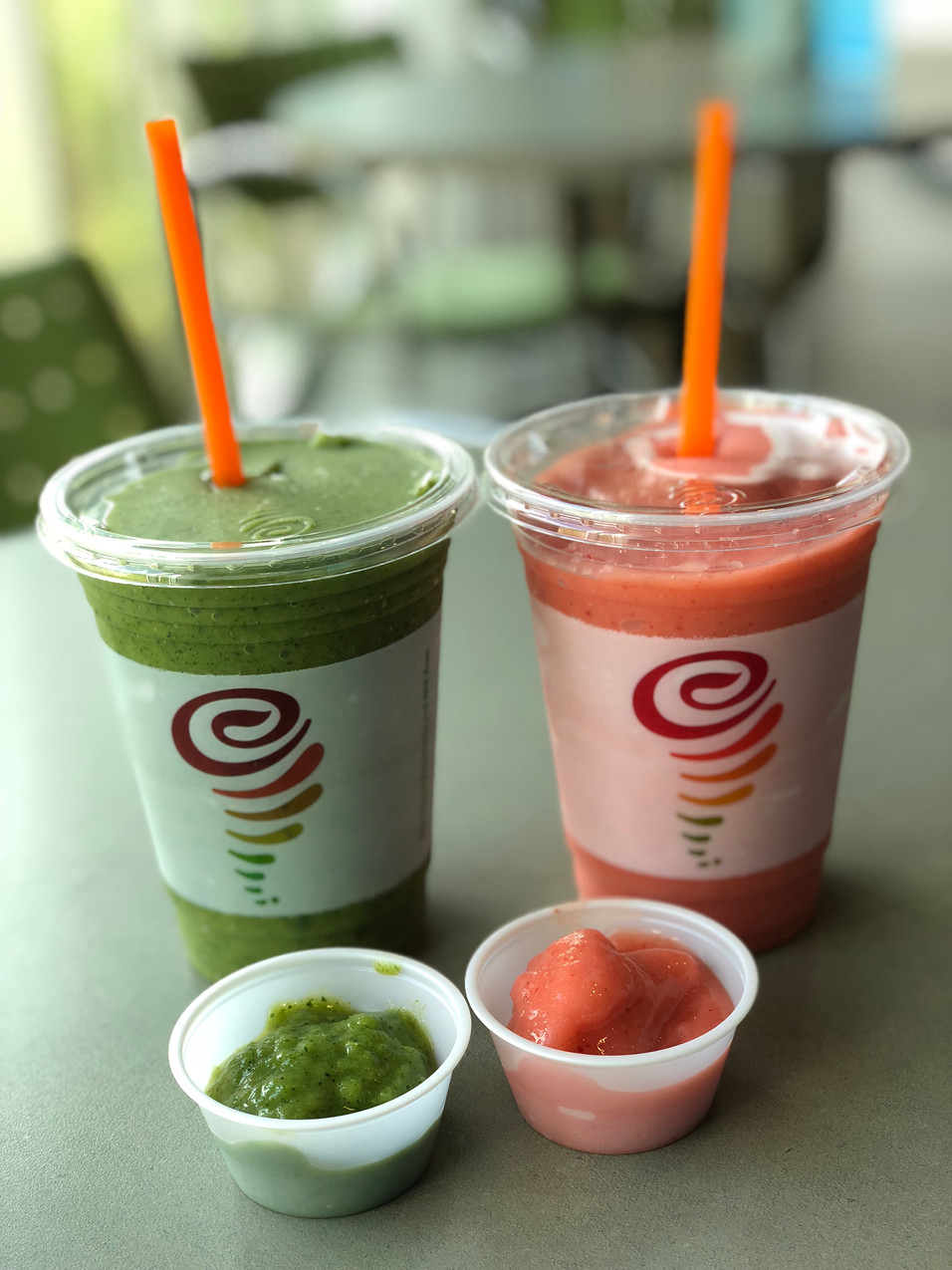 Green and pink smoothie with samples