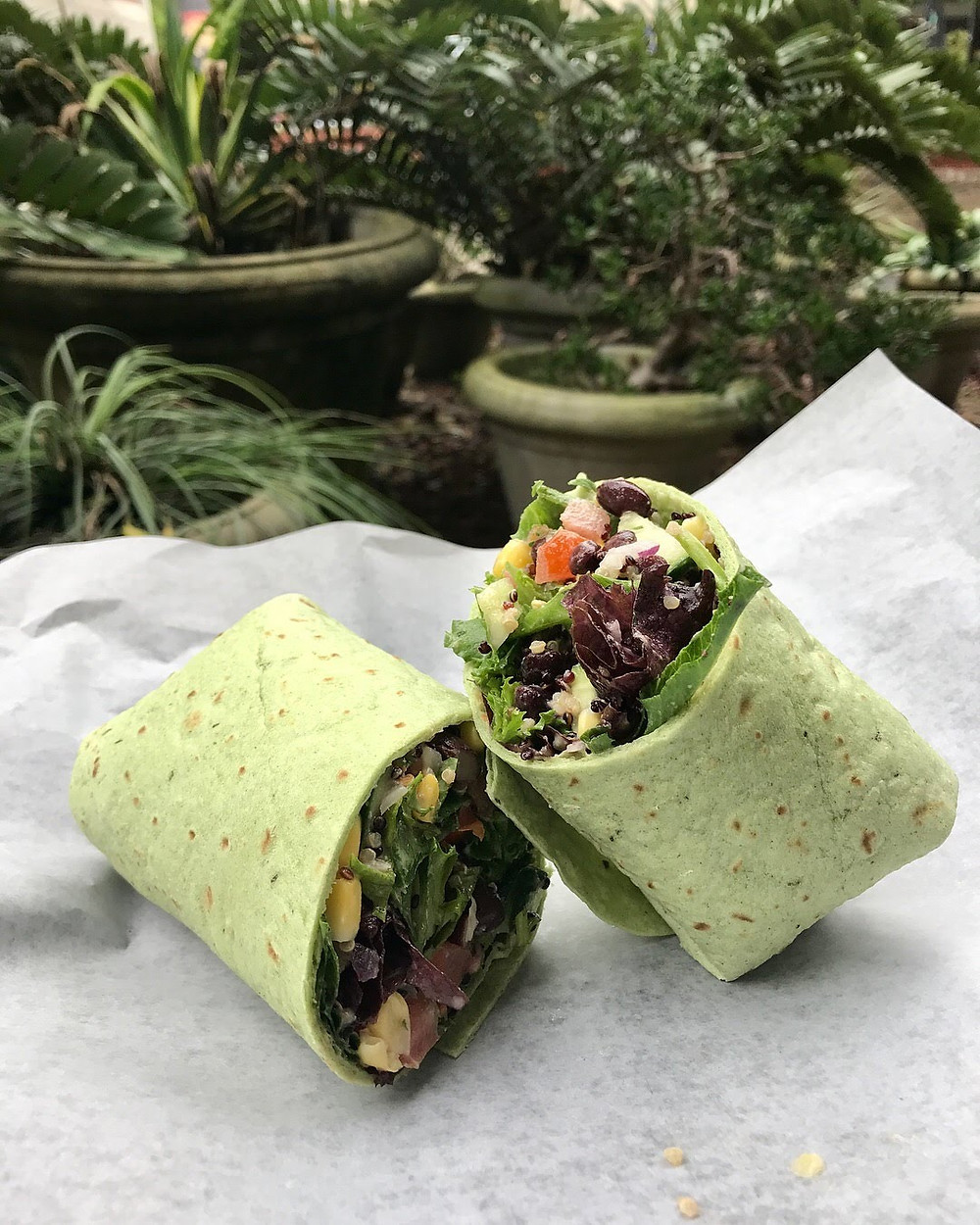 A chopped and wrapped wrap cut in half.