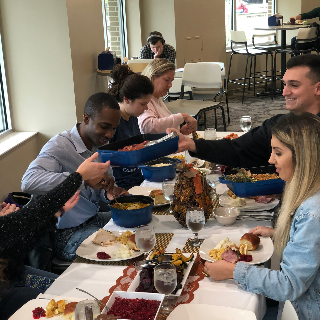 Friendsgiving action shot of people