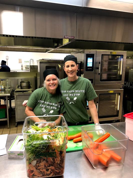 Two ladies in the Cafe preparing vegetables.