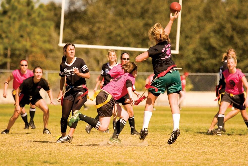Girls playing flag football.
