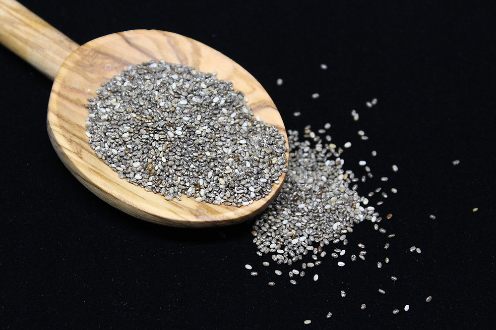 A wooden spoon of chia seeds.