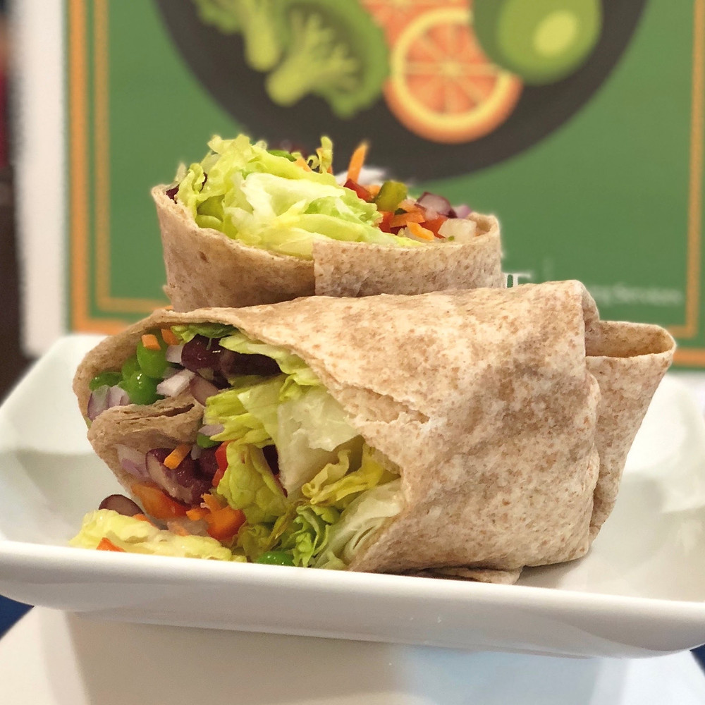A wrap cut in half from the Cafe.