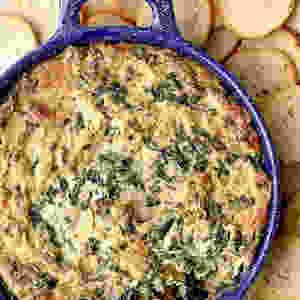 A big bowl of artichoke spinach dip.
