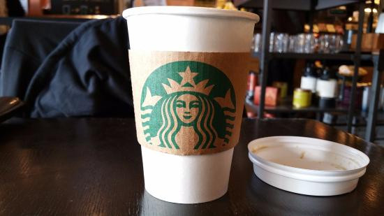 A Starbucks cup sitting on a table.