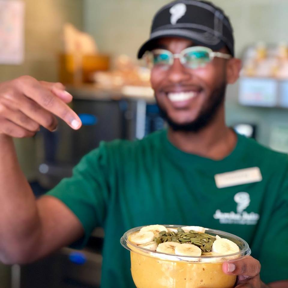 african american male pointing at his smoothie bowl