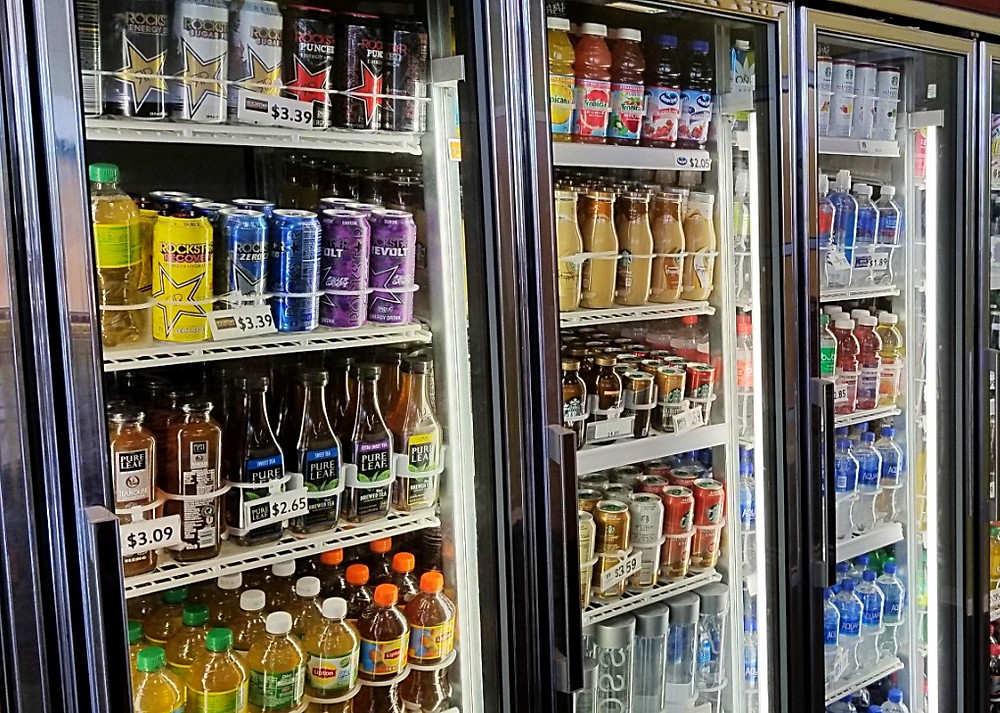 The caffeinated beverages in the fridge at Outtakes.