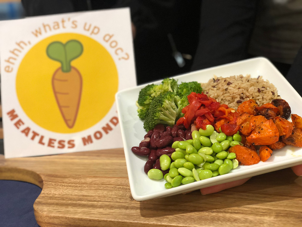 A plate of veggies and rice, with a sign that say Meatless Monday.