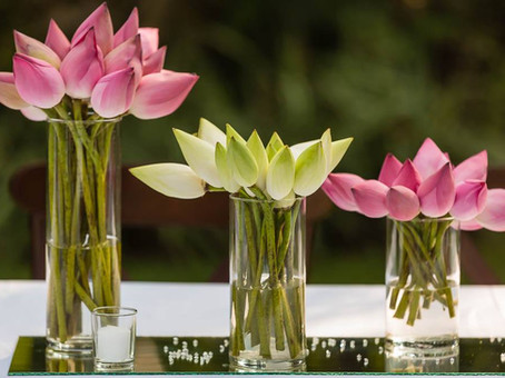Using Pink and White Lotus Flowers for centerpieces for destination wedding in Sri Lanka