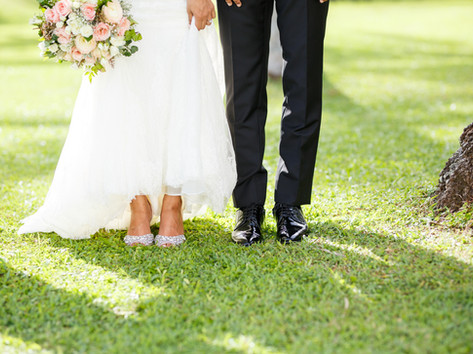Romantic photograph of lovely Bride and groom's shoes.