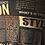 Thumbnail: Black +Gold Newsprint cross strap sheath
