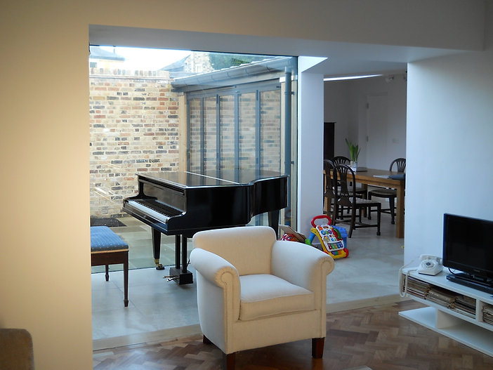 Interior with piano and courtyard