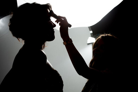 Louise doing touch up make up on set