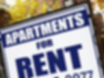 For rent sign in front of apartment buil