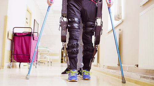 Legs of disable man in the robotic exosk