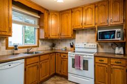 oak cabinets & stone backsplash