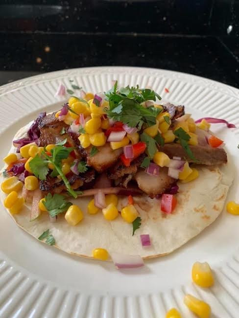 Honey ginger glazed pork belly tacos by Nathan
