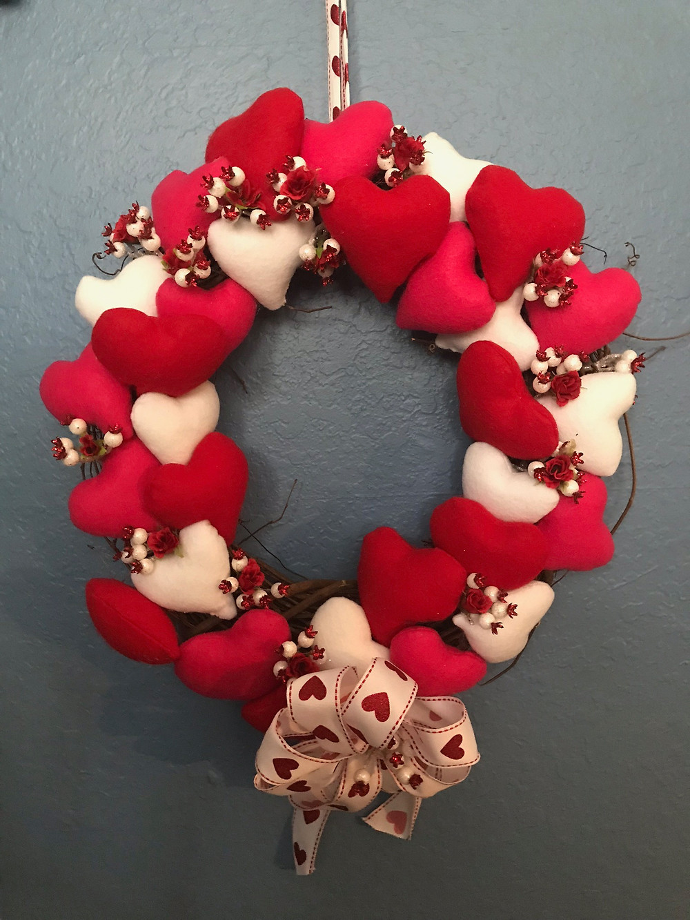 Felt hearts, wire ribbon, and natural wreath.