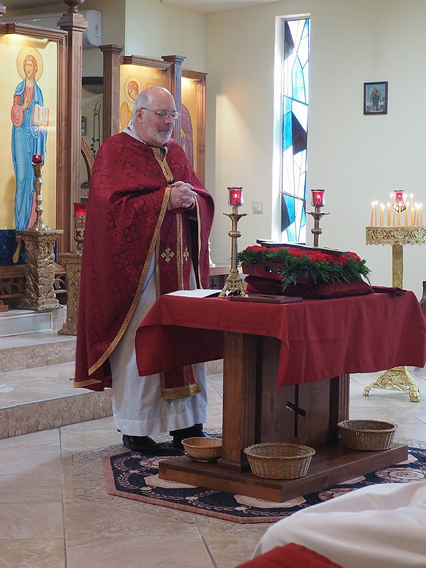 Fr. Bob liturgy at St Melany.jpg
