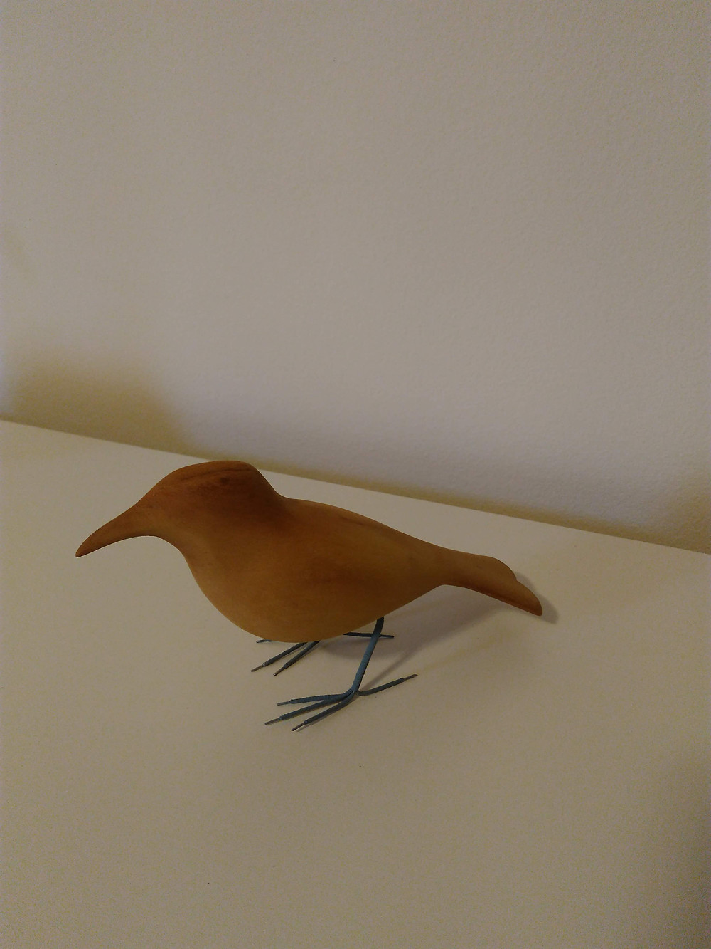 escultura em madeira pássaro