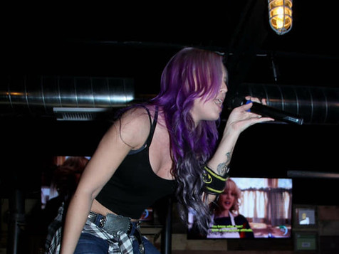 Our Bartender, Ashley, likes to sing on the bar!