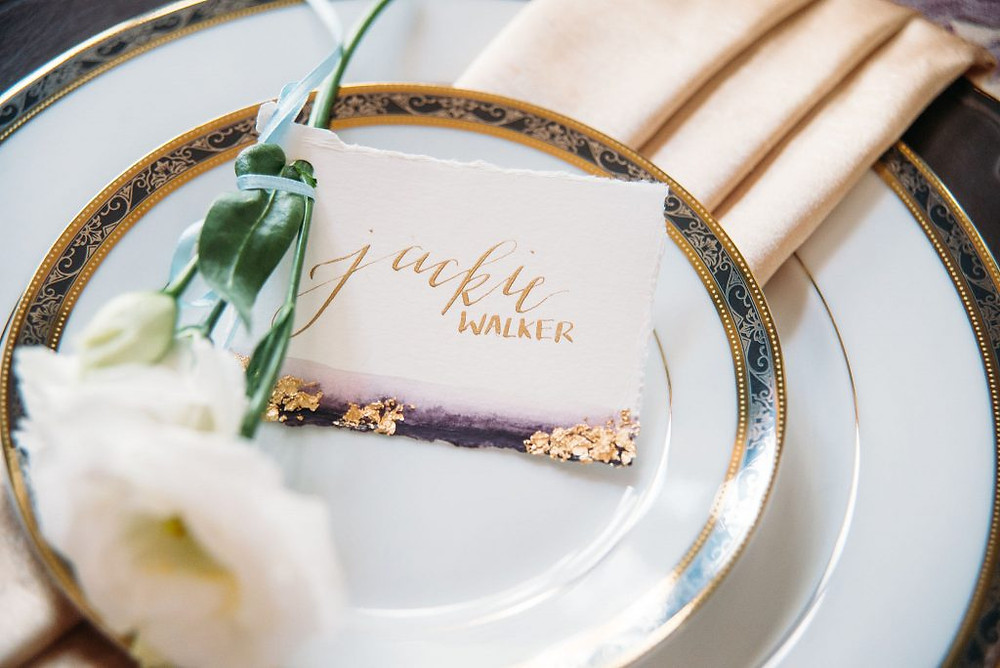 Wedding Place Cards on handmade paper with watercolor accent and gold leaf. Photo: San Angel Photo