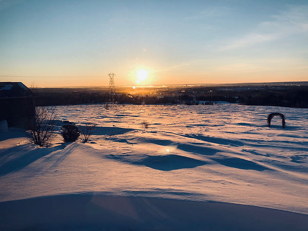 Snowy sunset view of moncton