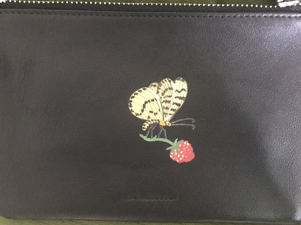 Leather pouch hand painted with a butterfly resting on a raspberry