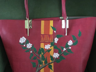 Vegan leather tote painted with stripes, owners initials and peonies