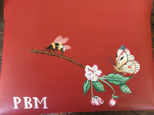 Leather clutch hand painted with owners initials, branch of apple blossoms, a bee and butterfly