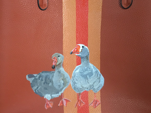 Leather tote hand painted with a portrait of owners geese