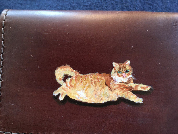 Leather card case painted with the owner's pet cat