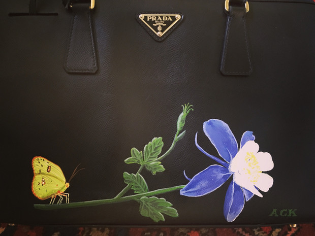 Prada bag updated with hand painted columbine and ghost moth, with owners initals
