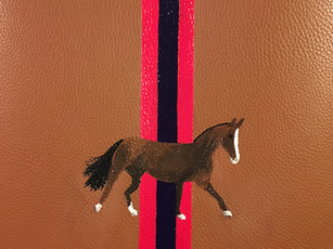 Leather bag with stripes and owner's horse