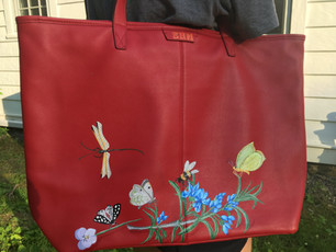 Leather tote hand painted with rosemary and various insects