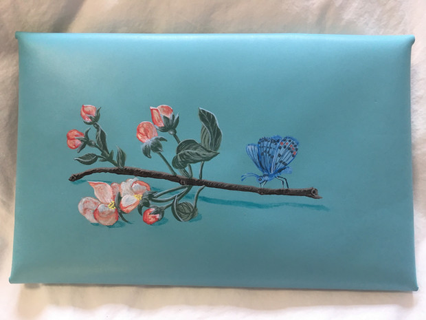 Leather clutch hand painted with apple blossoms and blue butterfly