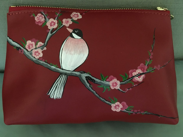 leather pouch hand painted with a branch of cherry blossoms and a bird