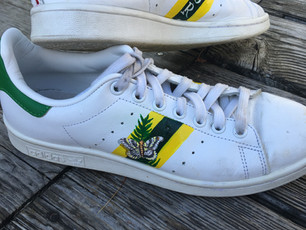 Stan Smith sneakers hand painted with stripes, owners initials, butterfly and fern