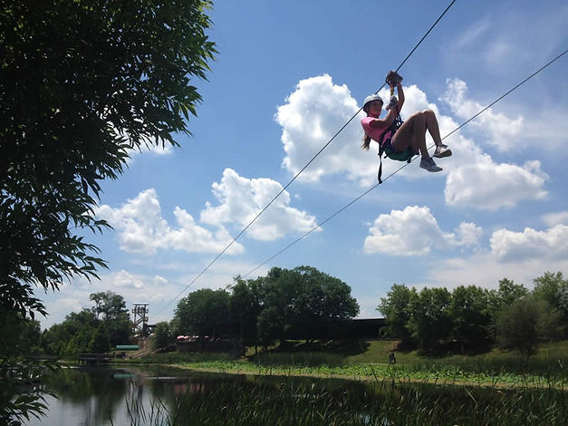 Zip line over lake with American Adventure Parks