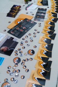 Event table with buttons, pamplets, cards, & other promotional material Cassandra Voss Center, 2016