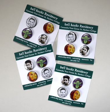 Collection of buttons designed for the 4 years of bell hooks residencies at St. Norbert College (2 of the 4 designed by other artists) Cassandra Voss Center, 2016-17