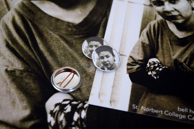Detail of buttons, prints, & posters Cassandra Voss Center, 2015