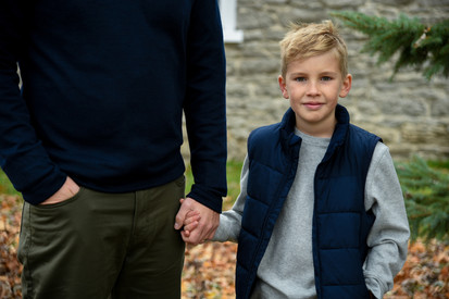 Holding onto Dads hand, this little dude looks so cool in his new fall clothes.