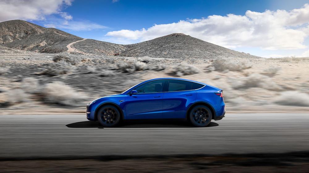 A blue Tesla Model Y all-electric vehicle