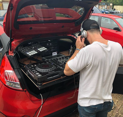 Our In-House DJ Performing at a Car Meet