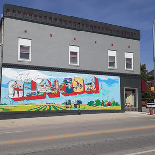 Clarion: Seat of Wright County Clarion, Iowa  2019  Situated in the center of Wright County Clarion is the epicenter of local life. This mural will capture everything from key historical figures to the county courthouse and local industry leaders.