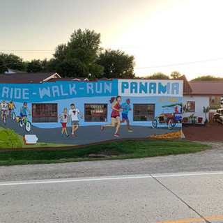 Ride-Walk-run: Panama Panama, Iowa  2019  On the side of this service station turned family-owned brewery the importance of being active in Shelby County. Imagery featured ties into the theme of Ride - Walk - Run as well as the brewery and owner's collection of Model Ts.