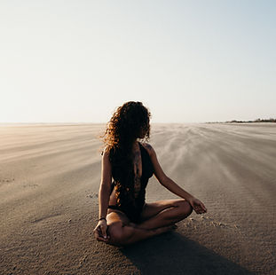 woman-sitting-on-sand-4431090.jpg