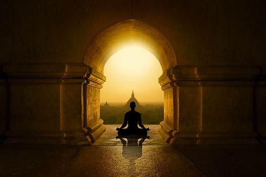 Man with yoga pose in buddhist temple.jp